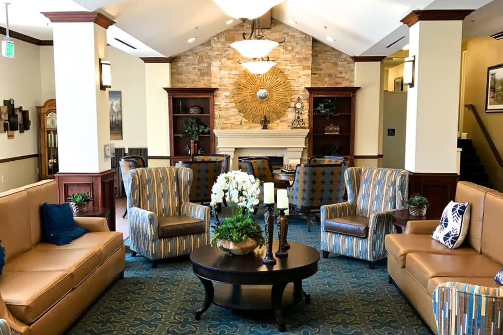 Spacious living area with wood-burning fireplace at Pacifica Senior Living San Leandro in San Leandro, California