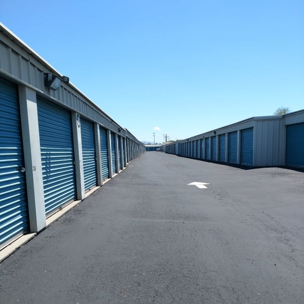Outdoor storage units with blue doors at StorQuest Self Storage in Tucson, Arizona