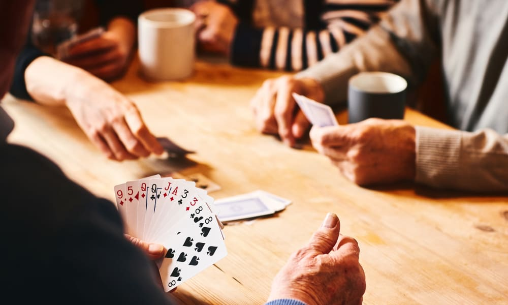 Residents playing cards at Brightwater Senior Living of Tuxedo in Winnipeg, Manitoba