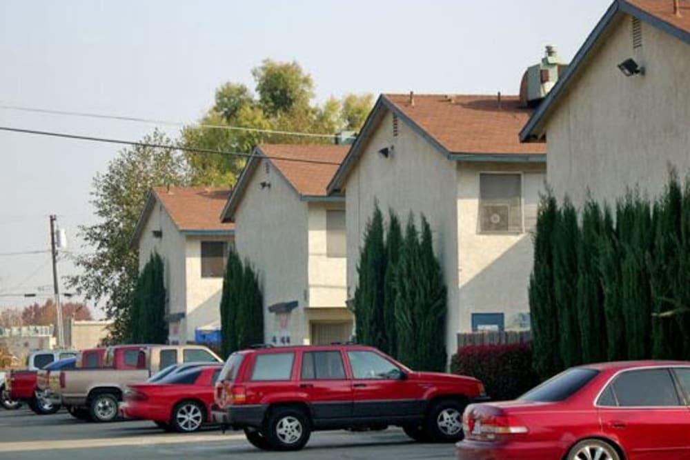 Parking and units at El Potrero Apartments in Bakersfield, California