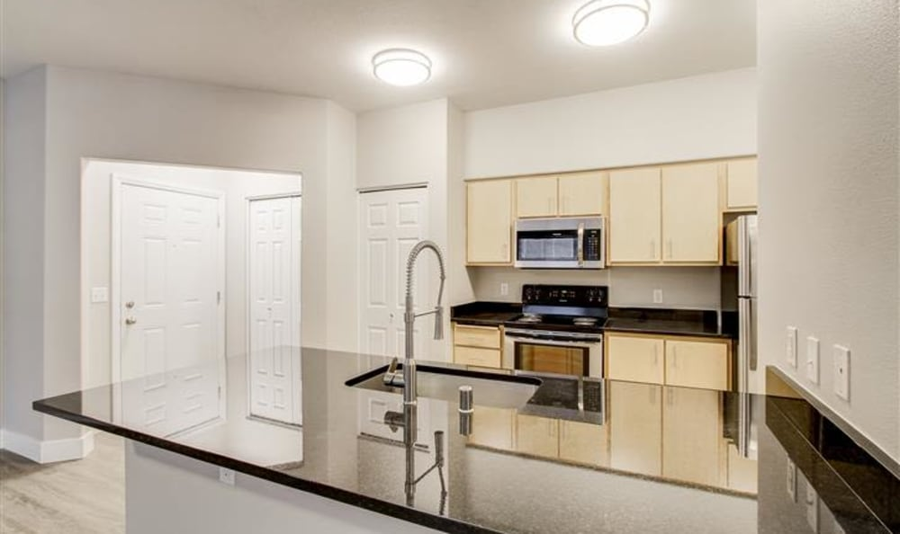 Over the counter look at the kitchen in a new unit at River Trail Apartments in Puyallup, Washington