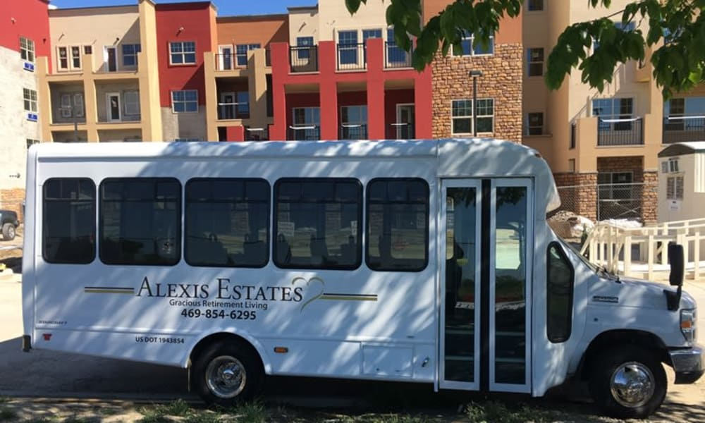 Community travel bus in front of Alexis Estates Gracious Retirement Living in Allen, Texas