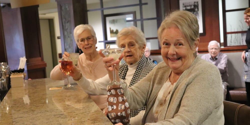 Residents enjoying beverages at The Springs at Carman Oaks in Lake Oswego, Oregon.