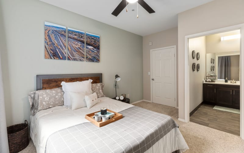 Spacious master bedroom with plush carpeting at HighGrove Apartments in Everett, Washington