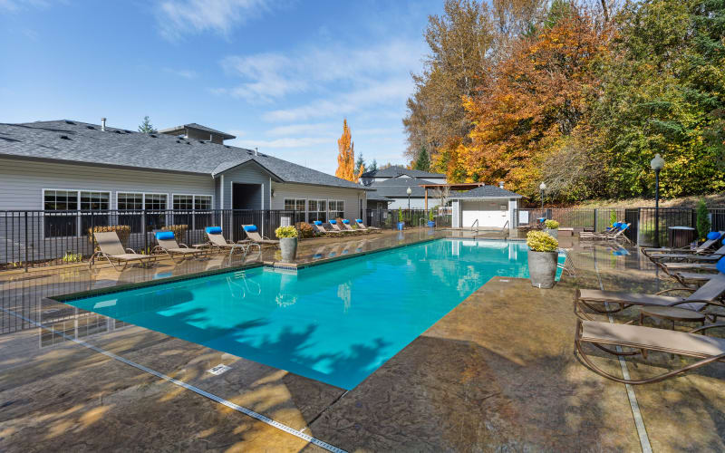 Large bright blue swimming pool at Pebble Cove Apartments in Renton, Washington
