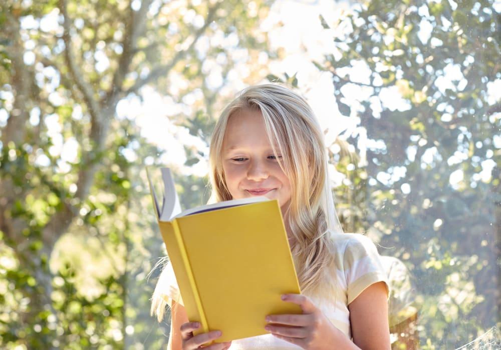 Child reading a book at Sofi Poway in Poway, California