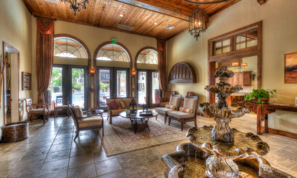 Lounge seating and mission-style decor in the lobby at Hacienda Club in Jacksonville, Florida