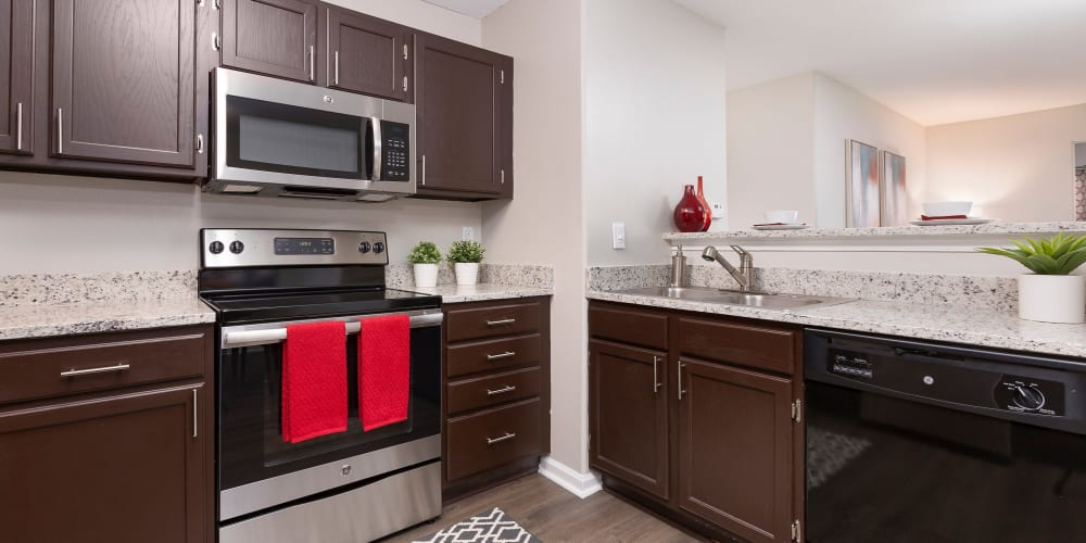 Beautiful kitchen with dark wood cabinets and very spacious at Ascend @ 1801 in Charlotte, North Carolina