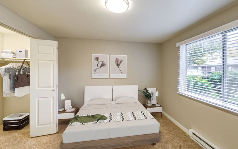 Spacious master bedroom with plush carpeting at Olin Fields Apartments in Everett, Washington