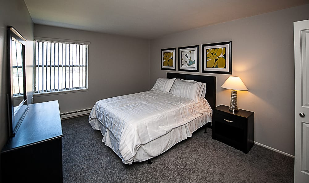 A bedroom at Spice Tree Apartments in Ann Arbor, MI