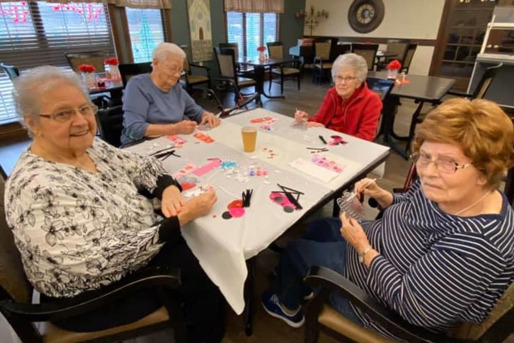Residents working on a craft project at Villas of Holly Brook Marshall in Marshall, Illinois