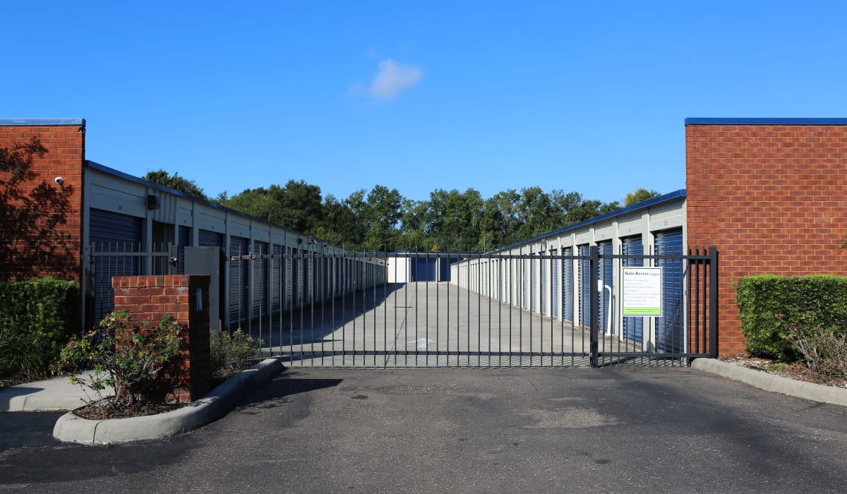Entrance and exterior storage units at Midgard Self Storage in Newberry, Florida