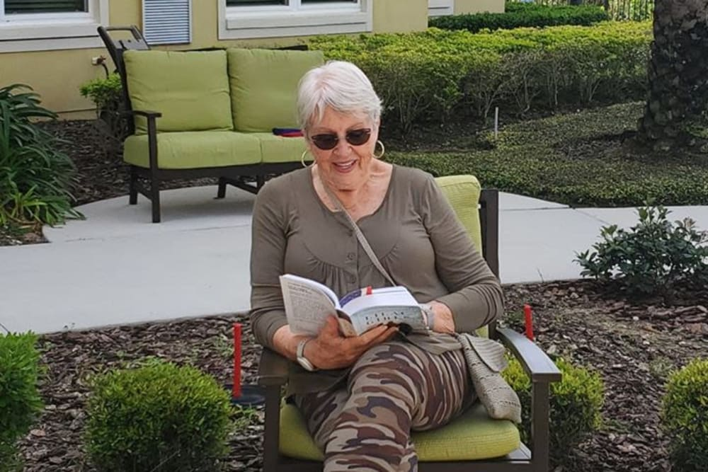 Resident reading at Azpira at Windermere in Windermere, Florida