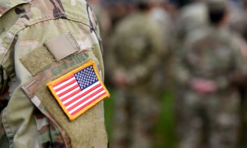Group of veterans remembering a fallen comrade near Centro Apartment Homes in Hillsboro, Oregon
