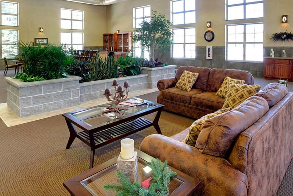 Brightly lit resident lounge with comfortable seating at Milestone Senior Living in Eagle River, Wisconsin.