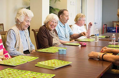Group of residents at Burr Ridge Senior Living enjoying a game of bingo