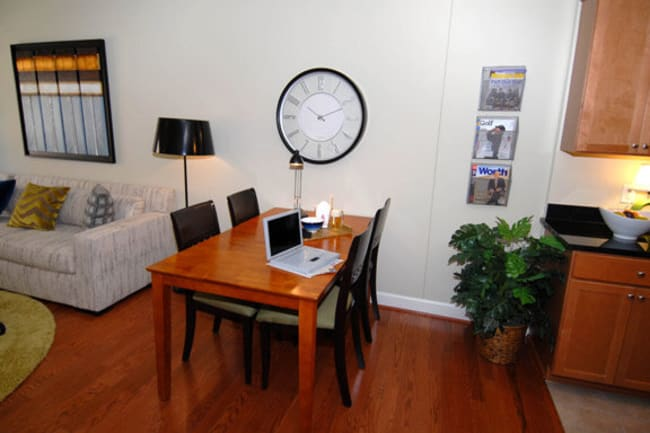 Living area with dining table at Argent Apartments in Silver Spring, Maryland