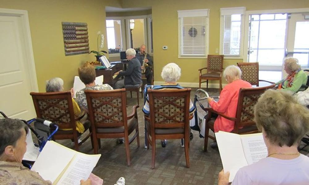 Residents performing a song as a group at Randall Residence of Tipp City in Tipp City, Ohio