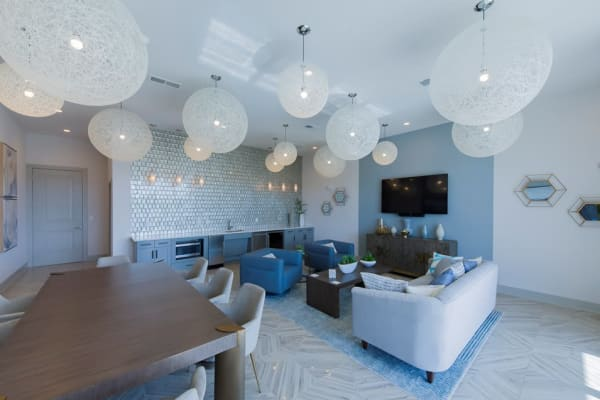 Living room with balloon globe lighting and modern furniture at a property by at WRH Realty Services, Inc
