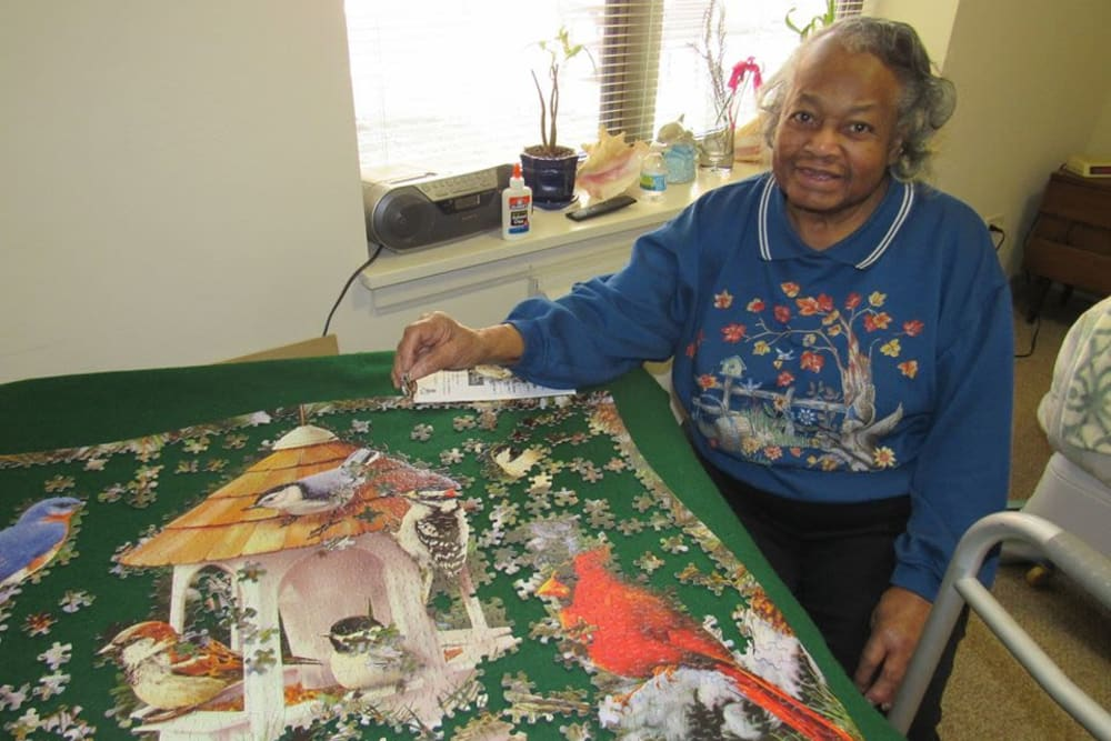 Resident working on puzzle at Victory Centre of Galewood