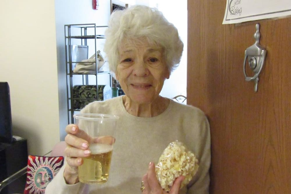 Resident with beverage and popcorn at Victory Centre of Vernon Hills
