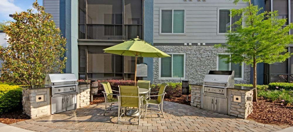 The Courtney at Lake Shadow offers a community BBQ grill in Orlando, Florida