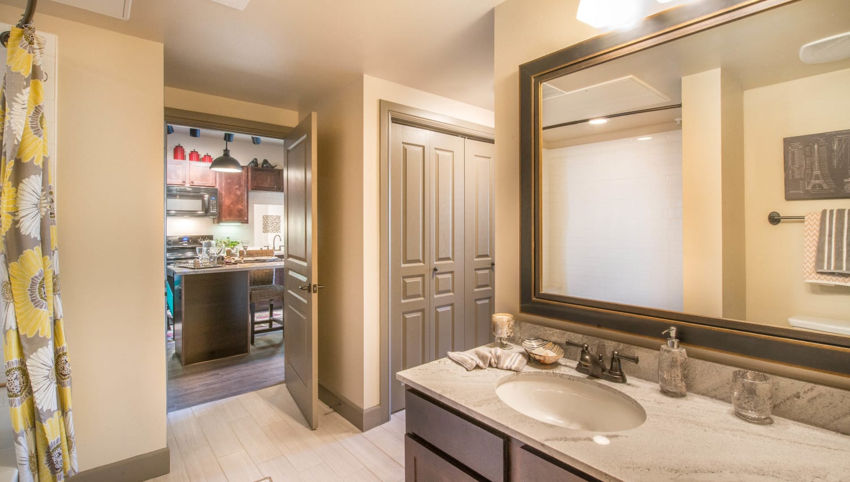 Granite countertop in a model home's guest bathroom at Union At Carrollton Square in Carrollton, Texas