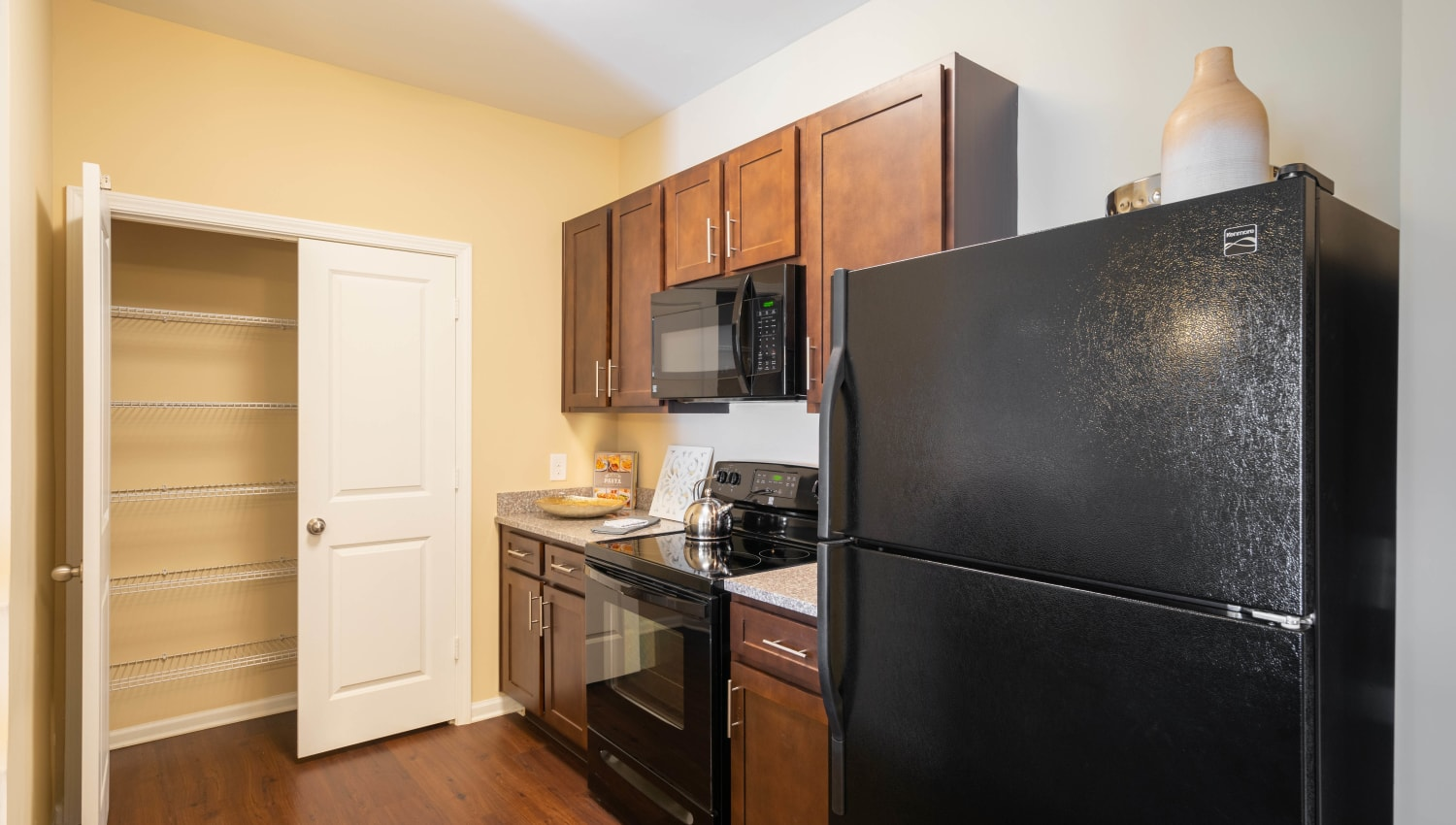 Model home's kitchen pantry for extra storage at Legends at White Oak in Ooltewah, Tennessee