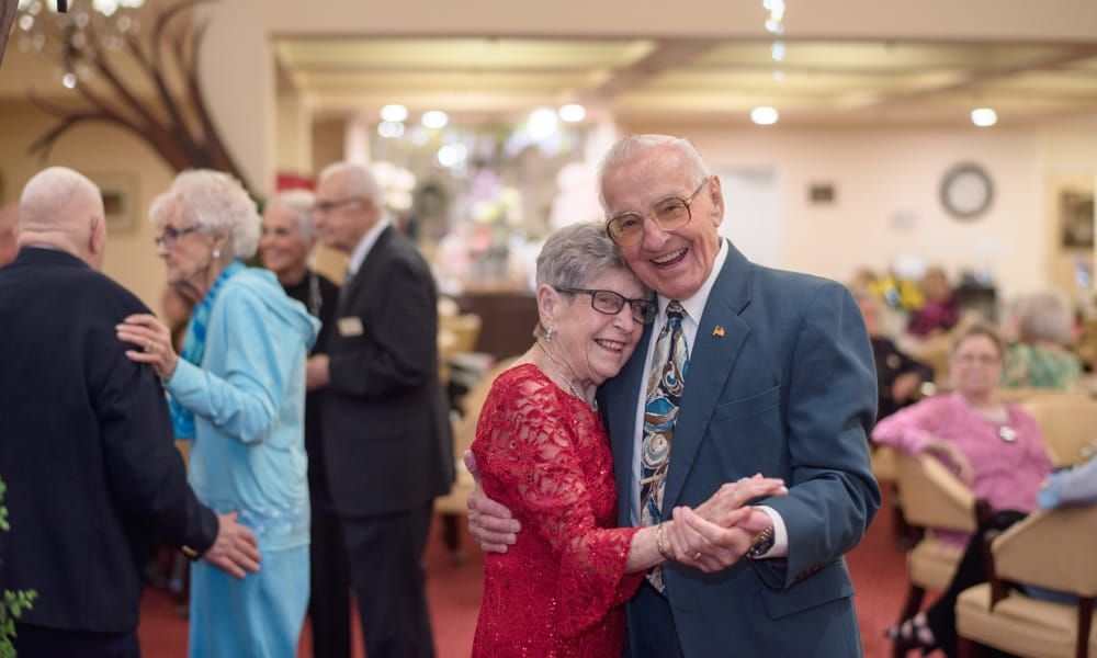 Elderly couples dancing at Alexis Estates Gracious Retirement Living in Allen, Texas