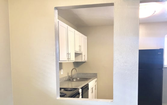View of the kitchen at Eagle Crest Apartments in Lakewood, Colorado