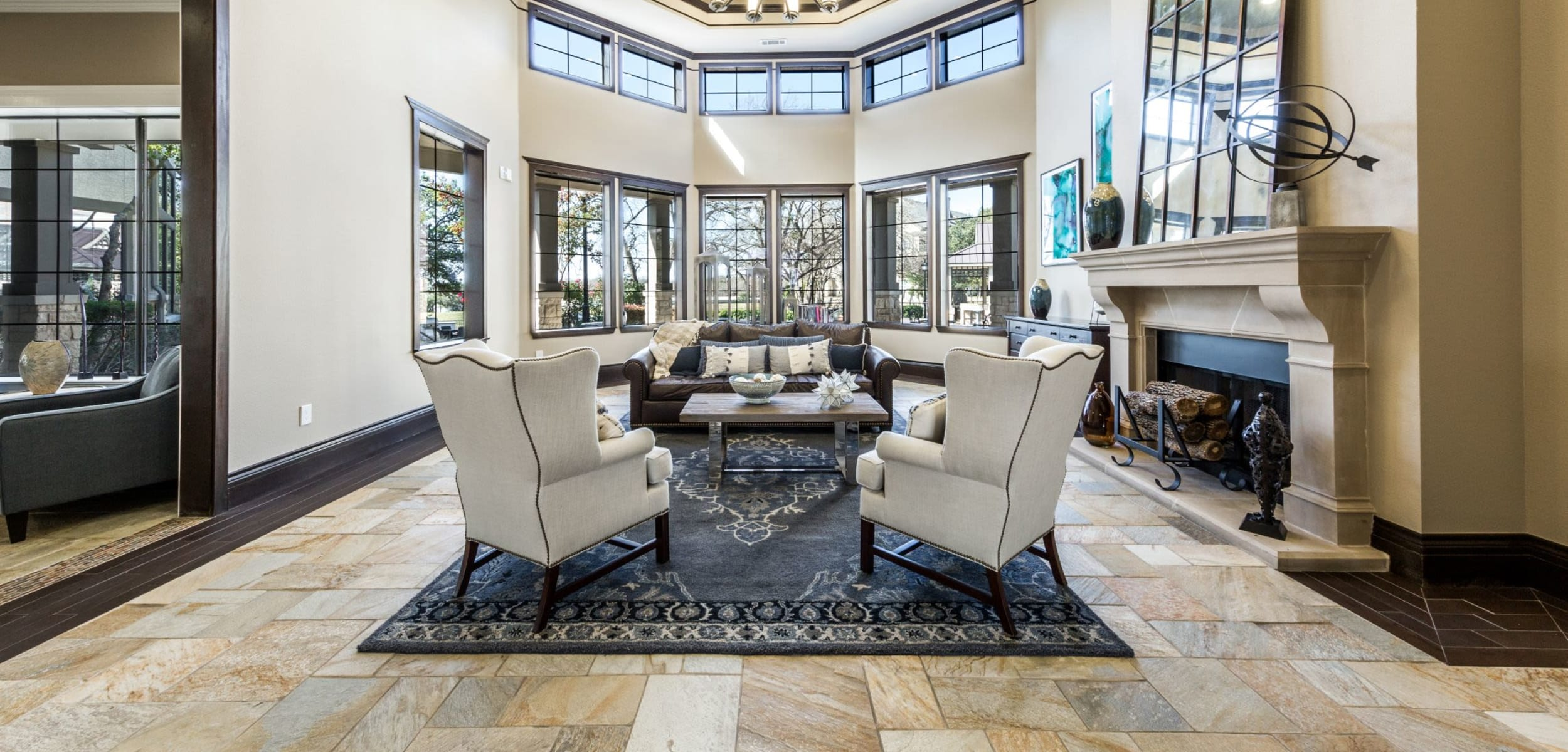 Elegant sitting area with tile floors and a large rug at The Marquis at Brushy Creek in Austin, Texas