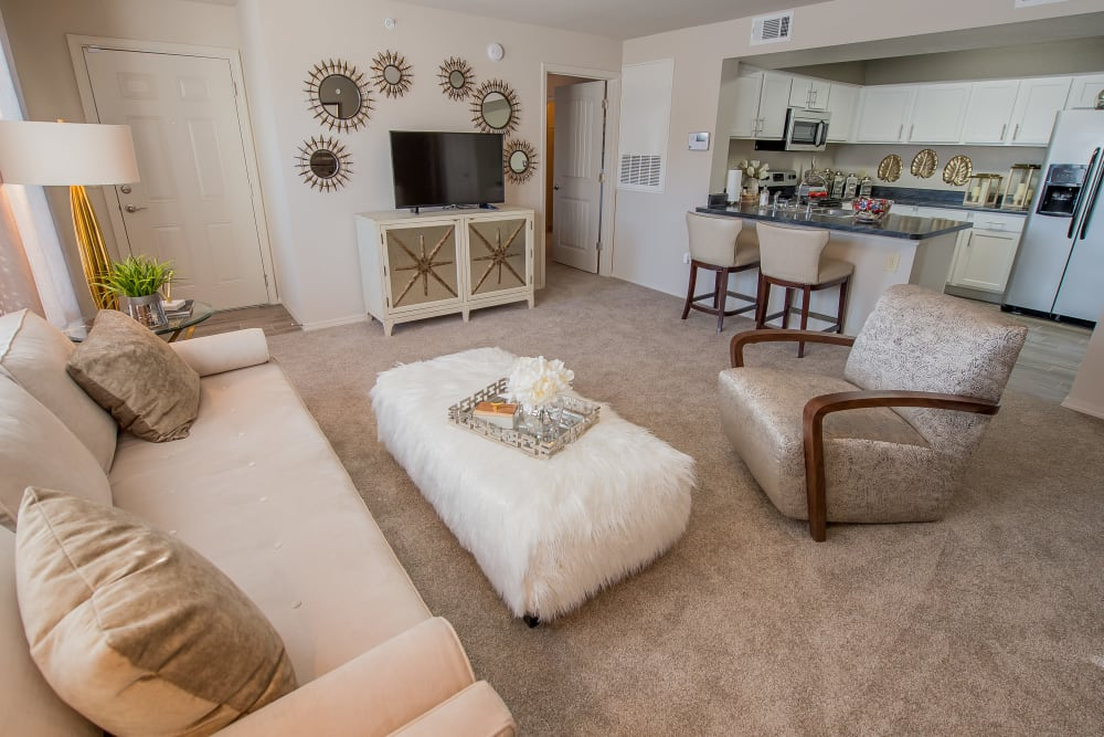 Well-lit living room at Watercress Apartments in Maize, Kansas