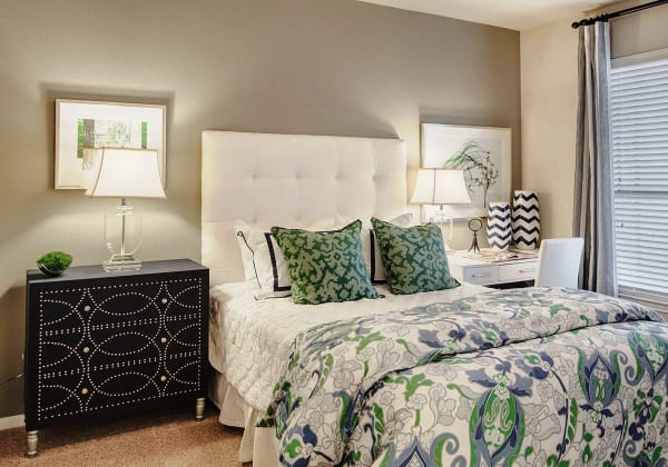 Naturally well-lit bedroom at Ridgecrest Apartment Homes in Austin, Texas