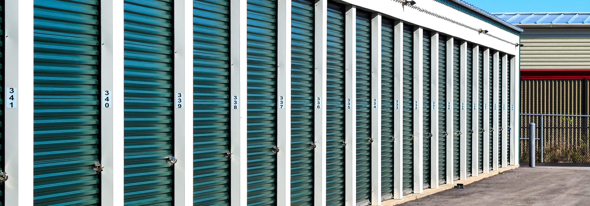 Apple Self Storage - Collingwood in Collingwood, Ontario, exterior units with green doors