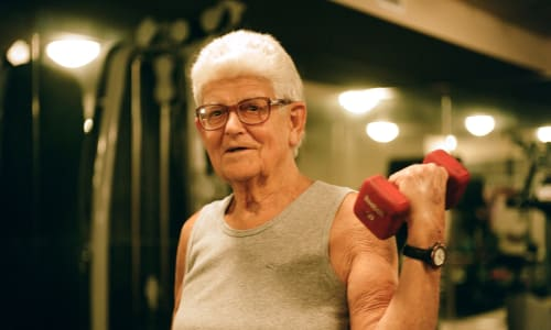 A resident exercising at a Merrill Gardens community.