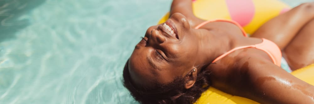 A woman relaxes in the pool at Four Seasons Apartments in Erlanger, Kentucky