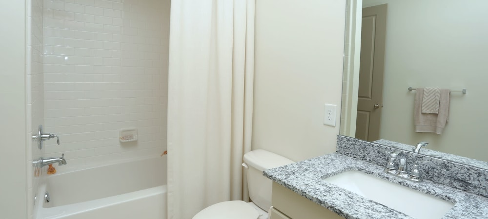 Spacious bathroom with large mirror and ample counter space at 2370 Main at Sugarloaf in Duluth, Georgia