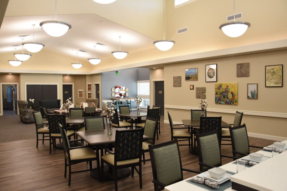Dining space at Shadow Mountain Memory Care in Phoenix, Arizona features breakfast bar seating, tables and comfortable sitting area