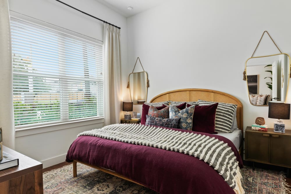 Luxuriously furnished primary bedroom with large bay windows at 4600 Ross in Dallas, Texas