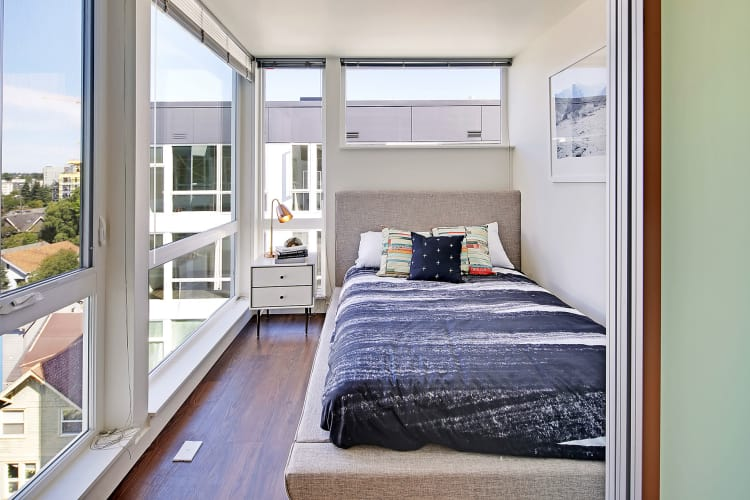 Luxury bedroom at Rooster Apartments in Seattle, Washington