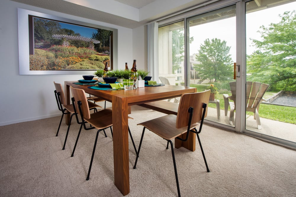 Dining room with a tree-lined view at Briar Cove Terrace Apartments in Ann Arbor, Michigan