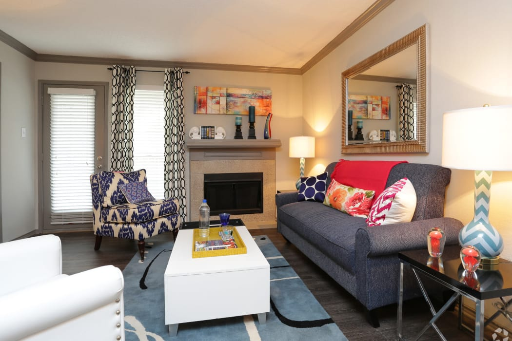 Modern decor in spacious living room of model home at Village Green of Bear Creek in Euless, Texas