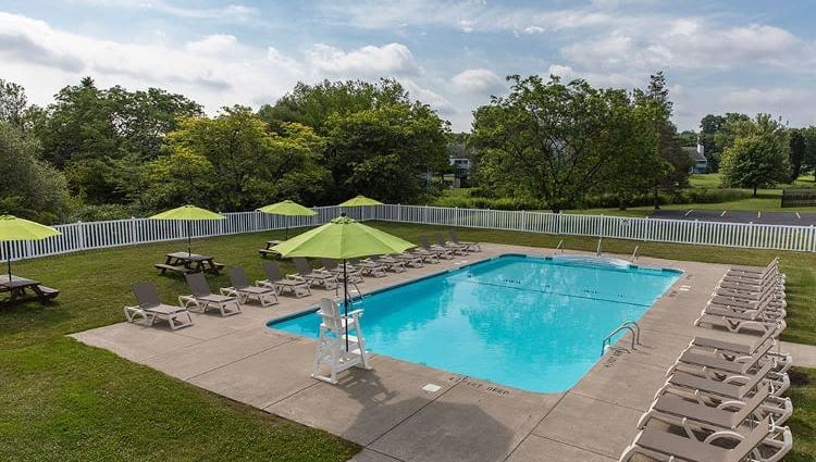 Sparkling swimming pool at The Meadows Apartments in Syracuse, New York