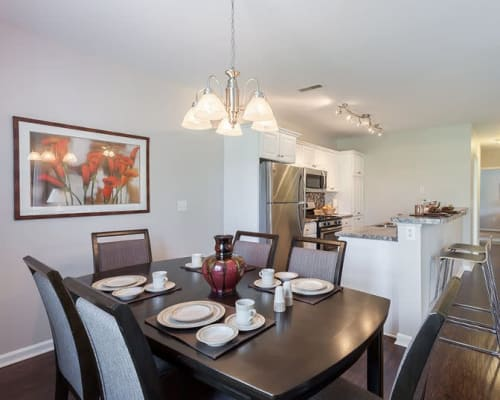 Spacious dining area at Oakmonte Apartments in Webster, New York
