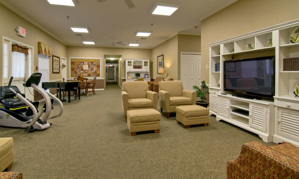 Entertainment room with comfortable seating at Highland Crest Senior Living in Kirksville, Missouri