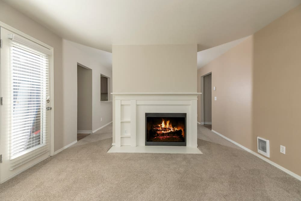 Beautiful fireplace in living room at Waterhouse Place in Beaverton, Oregon