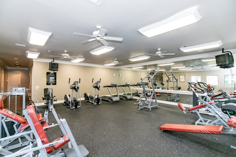 Weight room with machines at The Aidan in Lewisville, Texas