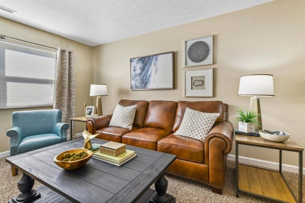 Beautifully decorated living room of model home at Hidden Creek Apartment Homes in Columbus, Ohio