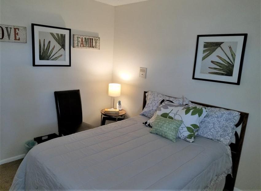 Cozy bedroom at Inglenook At Brighton in Brighton, Colorado