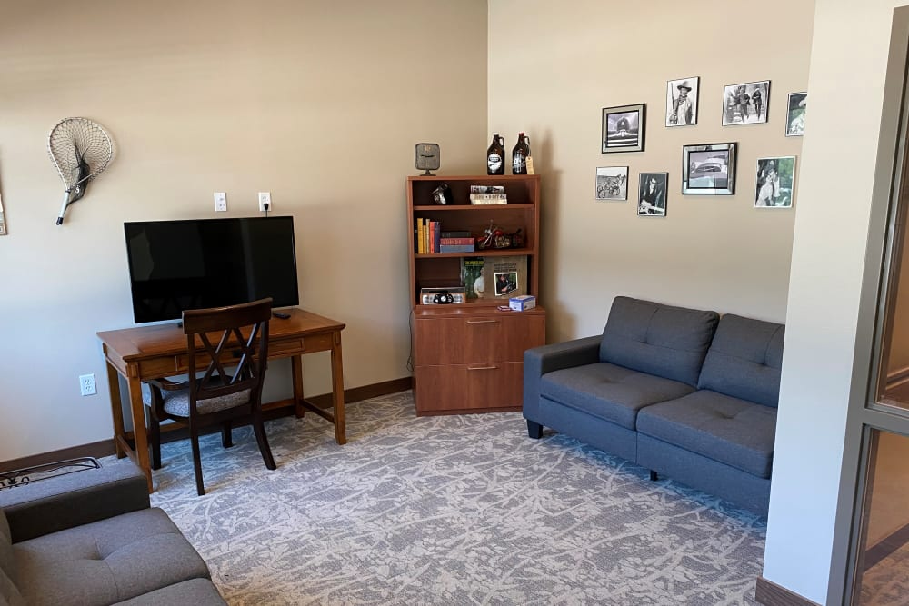Resident living space with TV and couches at Country Meadow Place in Mason City, Iowa